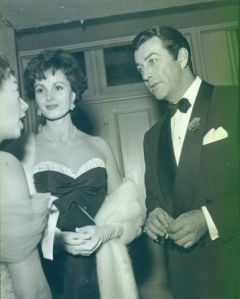 The impeccably dressed Mr. Taylor with Mrs. Taylor.