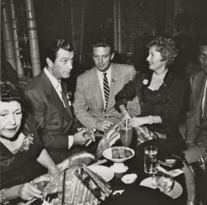 Robert Taylor and Barbara Stanwyck and Robert Stack at a party with Louella Parsons.
