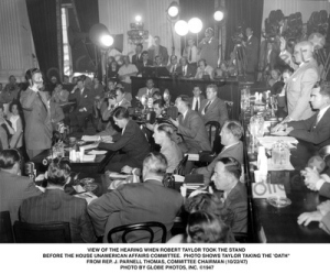 Robert Taylor being sworn in at the HUAC hearings, Oct. 22, 1947