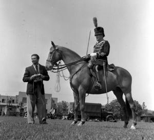 1953, Coronation of Queen Elizabeth II, Coronation Rehearsal, London, England, Robert Taylor with an Officer of the 4th Hussars on horseback .