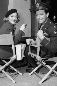 "Robert Taylor and Eleanor Parker on the set of ""Above and Beyond."""