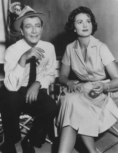 "Mr. and Mrs. Robert Taylor on the set of ""The Detectives."""