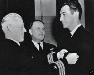 Receiving his wings. Left: Commander Paul E. Gillespie; Center Captain Dixie Kiefen, hero of the Battle of Midway.