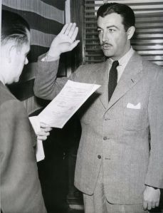 RT Joins Navy. LA,CA.Film Star RT shown as Lt. Wallace Trau administered the oath making the actor a lieutenant (jg) in the Naval Air Force. Taylor will start training as ferry pilot instructor. 2/10/43