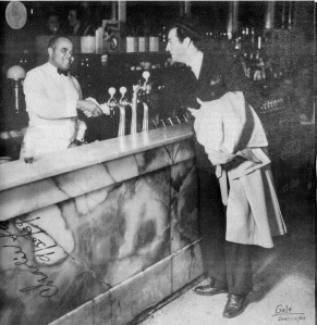 Robert Taylor visits with Charlie Scott at Penner's soda fountain in Beatrice, Neb. October 31, 1936