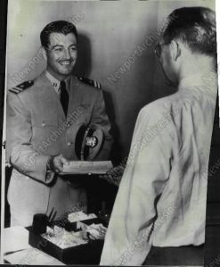 Robert Taylor receiving his discharge papers from the Navy.