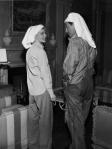 Robert Taylor teases Katharine Hepburn about her towel wearing.