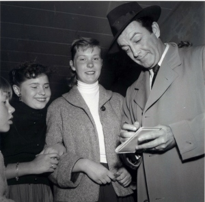 Signing an autograph for fans, ca. 1960.