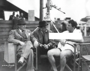 "Director Jack Conway & producer Michael Balcon with Robert Taylor on the set of film ""A Yank at Oxford"" filming in England."