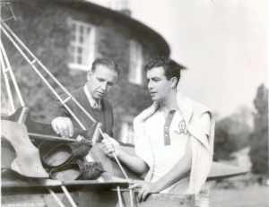 "Robert Taylor and British Sculling Champion Ted Phelps during the filming of ""A Yank at""Oxford."