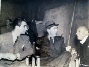 "Rt and Edmund Gwenn, seen here with Director Jack Conway, discussing a scene of MGM British Studios' ""AYaO,"" in which Maureen O'Sullivan and Lionel have leading roles."