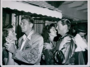 Dancing to the music or a Spanish musical group at Rory Calhoun's garden party in Beverly Hills Ronald Reagan and his wife Nancy, left, are seen beside Robert Taylor and his actress-wife Ursula Thiess, August 1958.