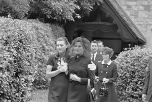 11 Jun 1969, Glendale, California, USA --- Original caption: Glendale, California: Ursula Thiess, widow of actor Robert Taylor (C) is comforted by her daughter, Manuela Thiess (L), as they leave the Church of the Recessional following funeral services for Taylor. In background is California Governor Ronald Reagan who delivered the eulogy. With the governor is Mrs. Nancy Reagan. Man between Gov. Reagan and Mrs Reagan is unidentified. --- Image by © Bettmann/CORBIS