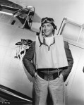 Actor Robert Taylor Posing by Airplane from Movie Scene